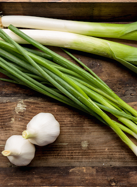 onion garlic and leek on a table